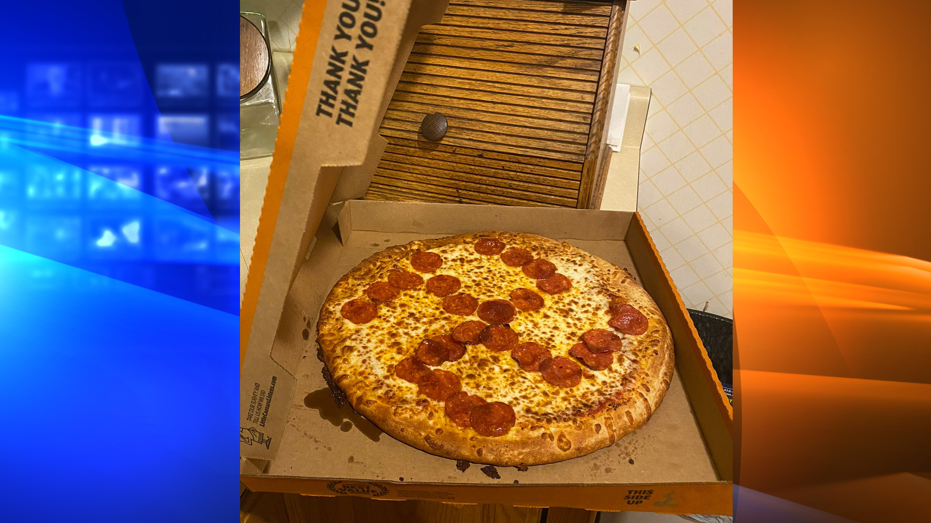 "Jason Laska says he grabbed a ""hot and ready pizza"" from the warmer at Little Caesars in Brook Park, Ohio, that had a swastika made out of pepperonis. (Jason and Misty Laska)"