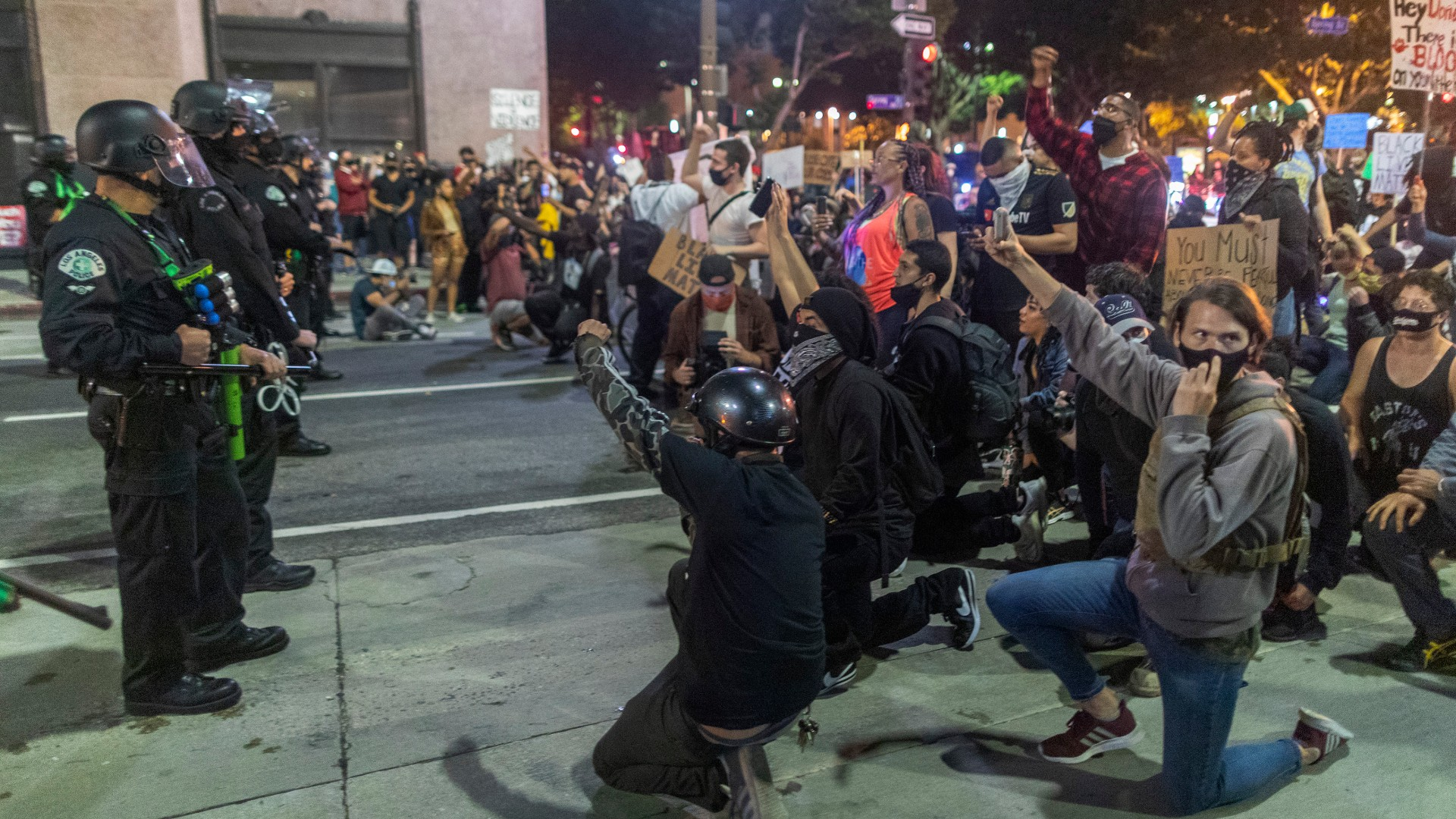 Protesters confront police as demonstrations continue over the killing of George Floyd on June 6, 2020 in Los Angeles, California. (David McNew/Getty Images)