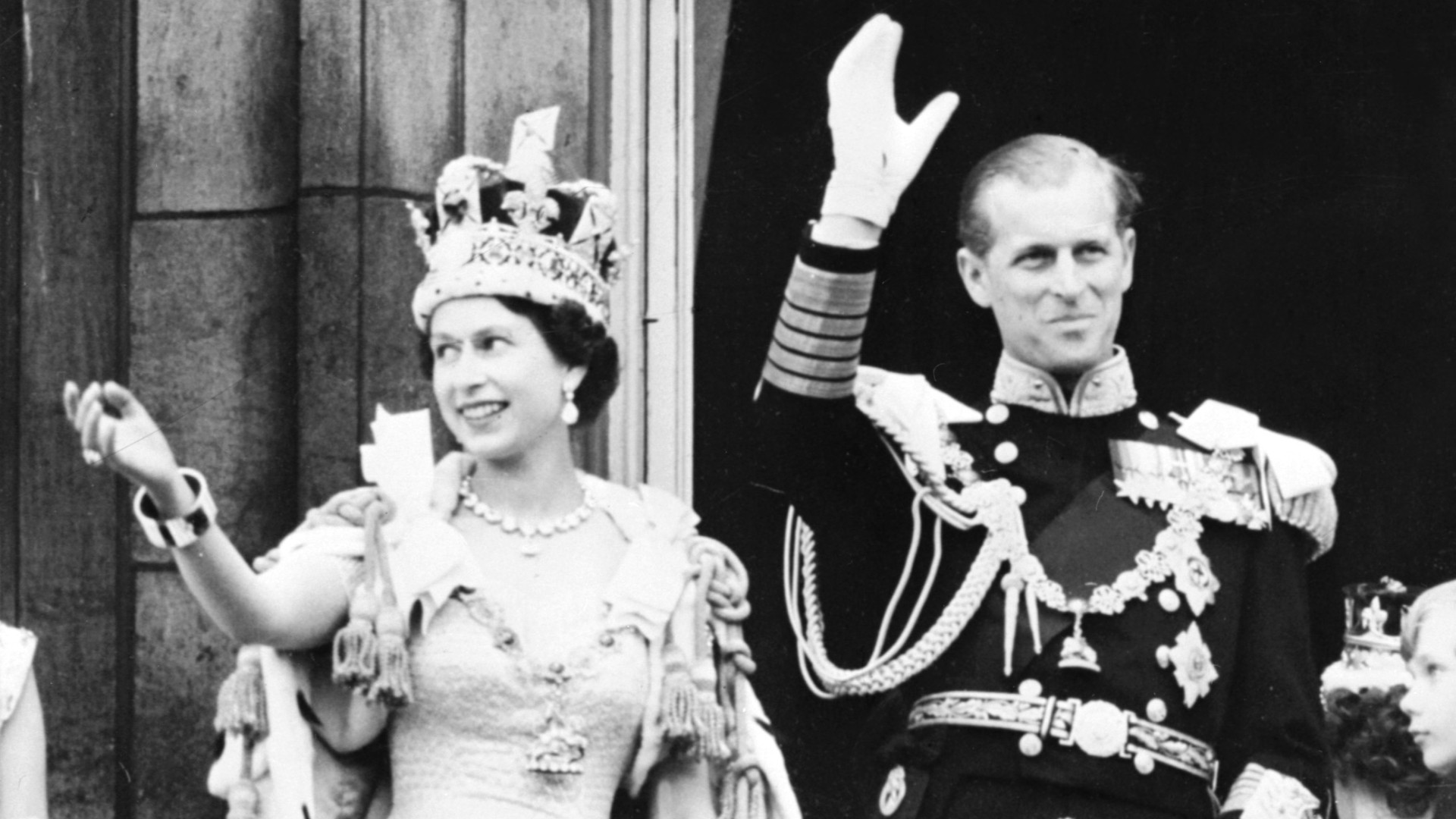 Britain's Queen Elizabeth II (L) accompanied by Britain's Prince Philip, Duke of Edinburgh (R) waves to the crowd, June 2, 1953 after being crowned at Westminter Abbey in London. (AFP via Getty Images)