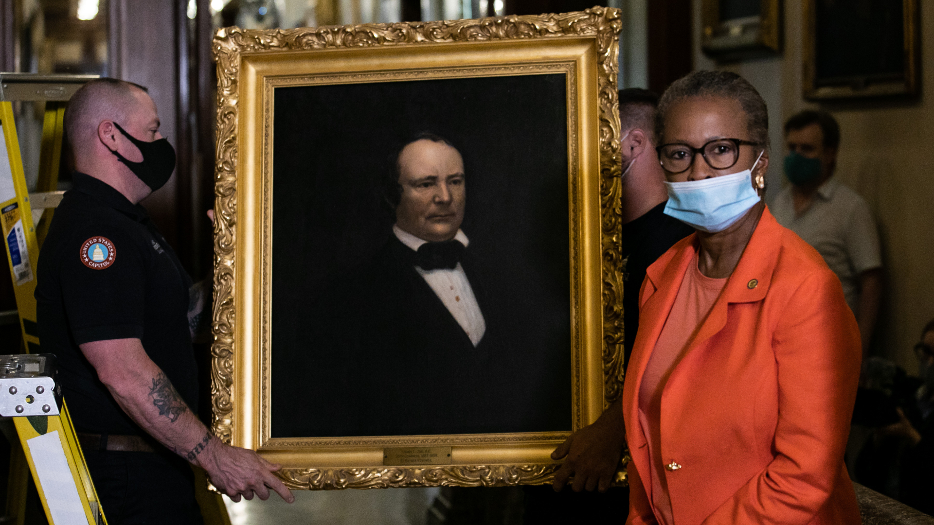 House Clerk Cheryl Johnson looks on as maintenance workers remove a painting of former speaker James Orr of South Carolina, from the east staircase of the Speakers lobby, on Capitol Hill, on June 18, 2020. (Graeme Jennings / Getty Images)