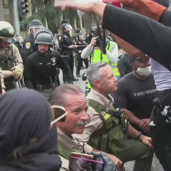 Riverside County Sheriff Chad Bianco takes a knee with demonstrators on June 1, 2020. (LLN)