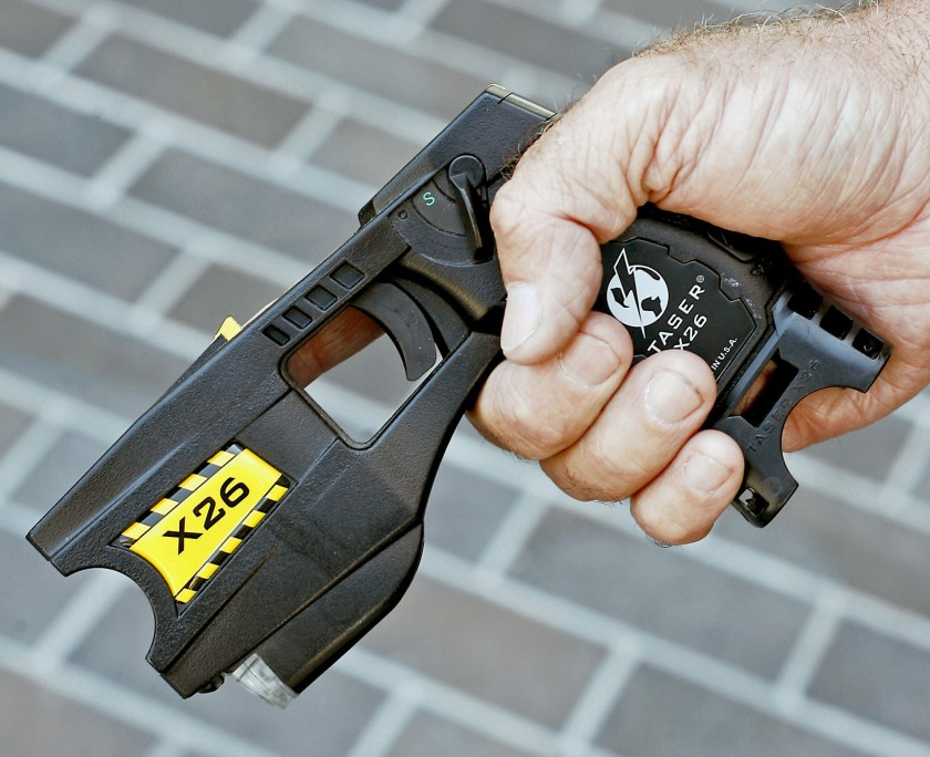 Amid a debate on police use of force, San Mateo County voted to purchase 310 new Tasers in June 2020, replacing some older ones, like the one above, seen in 2007. (Los Angeles Times)