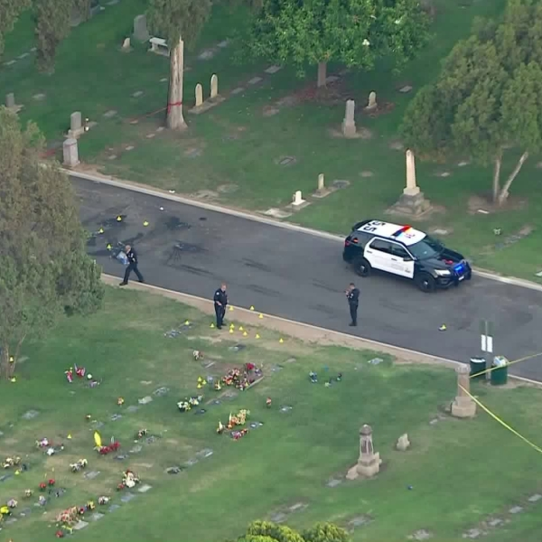 Police respond to investigate a deadly shooting at a cemetery in Santa Ana on June 24, 2020. (KTLA)