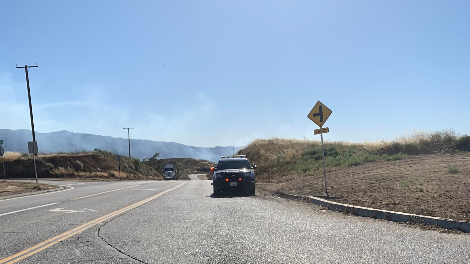 Crews respond to a brush fire spreading rapidly near Corona on June 8, 2020, in a photo provided by the California Highway Patrol.