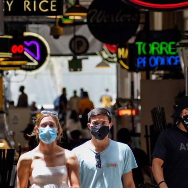 People wear face coverings at Grand Central Market in downtown Los Angeles on Thursday.(Kent Nishimura / Los Angeles Times)