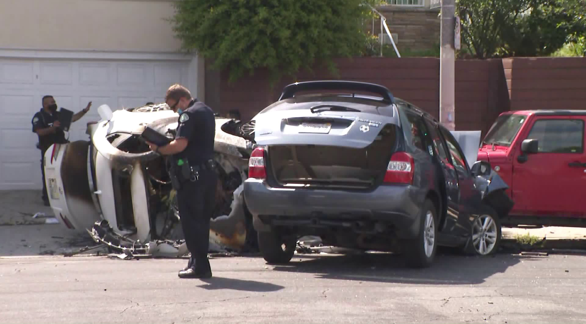 LAPD officials investigate a crash scene in the Westlake District on June 12, 2020. (KTLA)