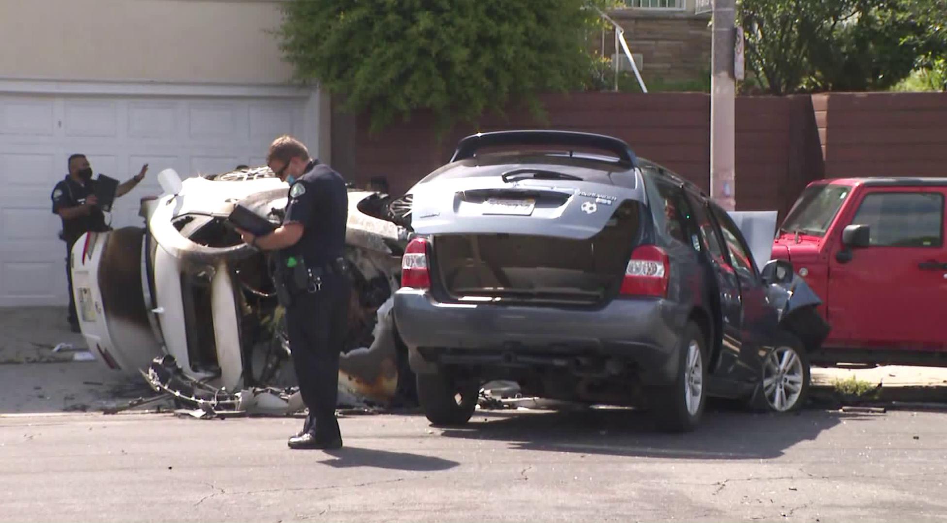 LAPD officials investigate a crash scene in the Westlake District on June 12, 2020. (KTLA)