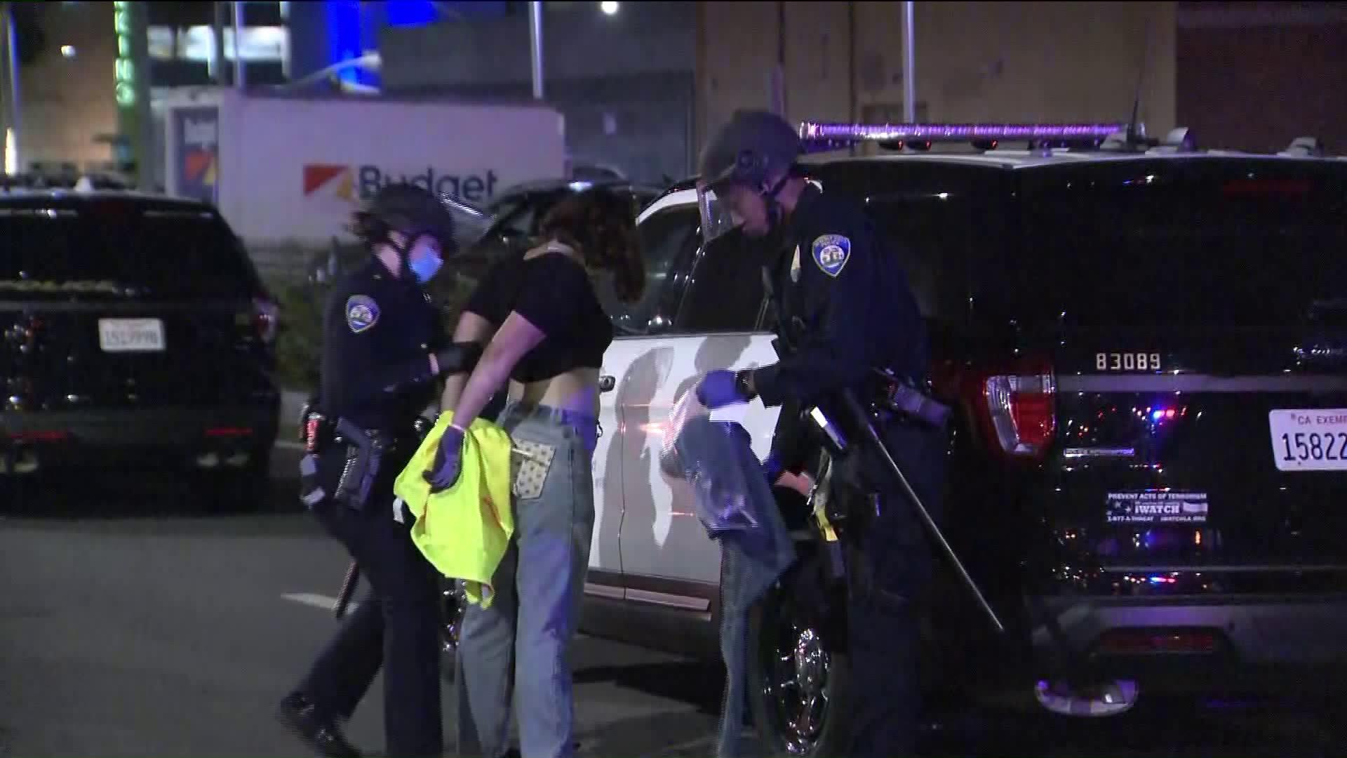A protester is arrested on July 23, 2020, in Beverly Hills. (KTLA)