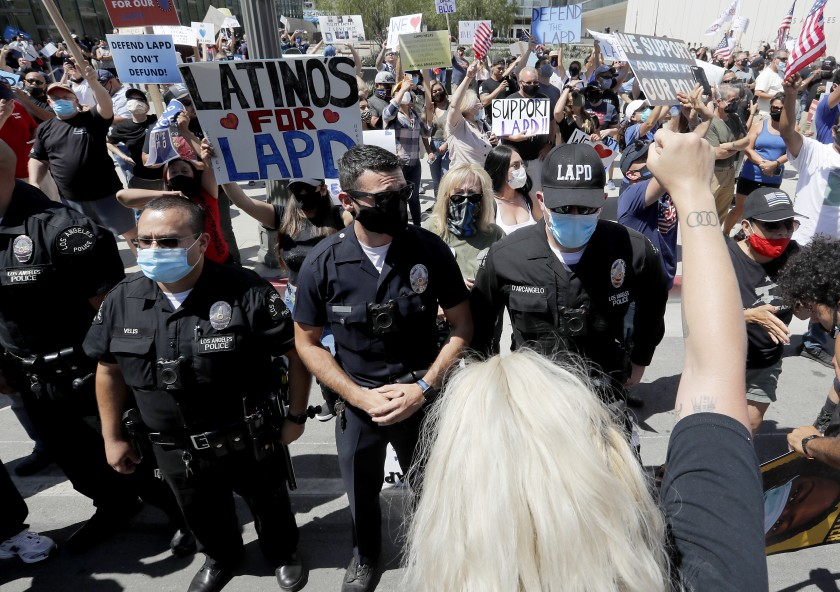 LAPD officers form a line to separate pro- and anti-police demonstrators outside LAPD headquarters in downtown Los Angeles on July 11, 2020. (Luis Sinco/Los Angeles Times)