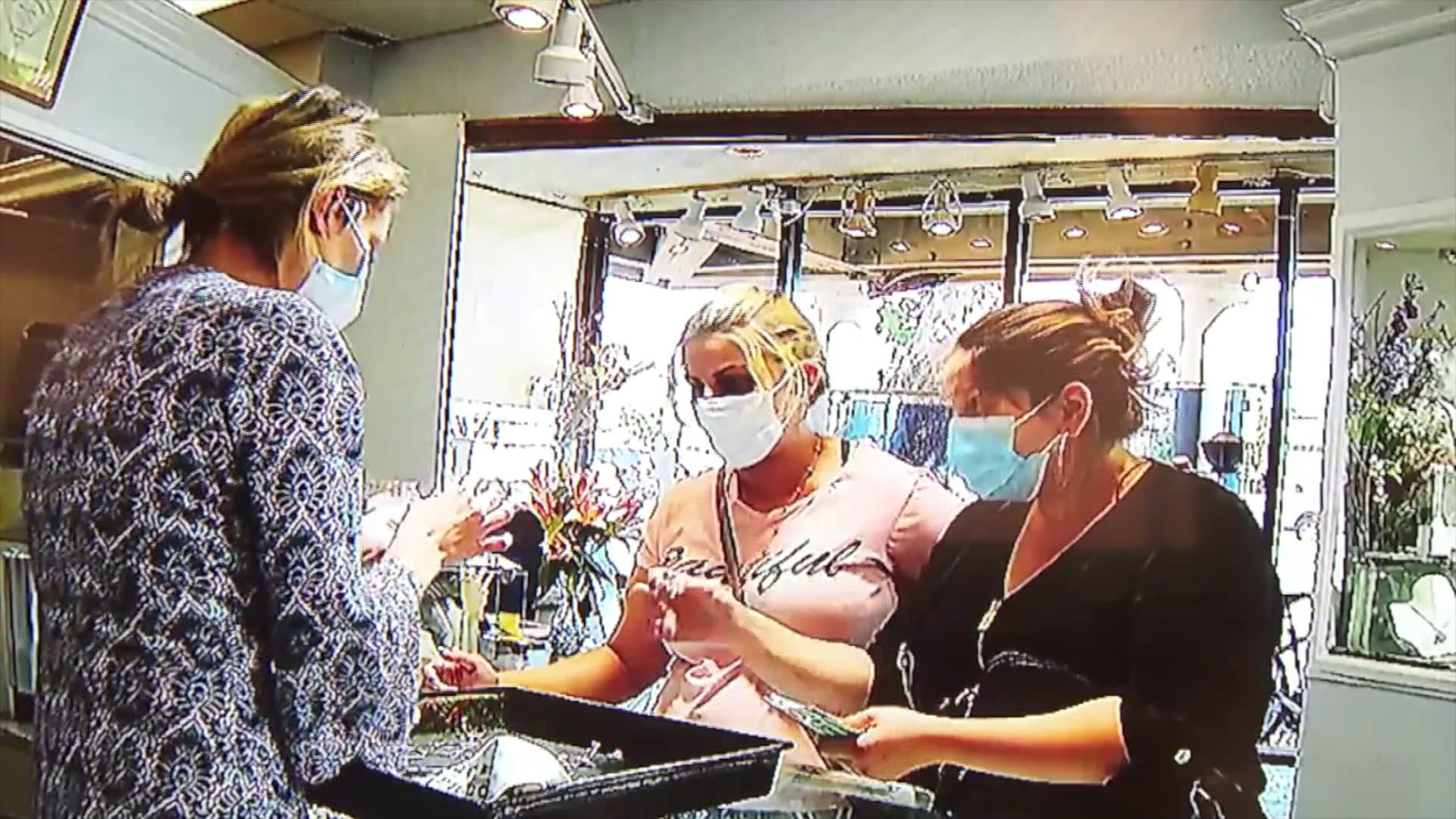 Two women were seen in security footage at Designs by Steven jewelry store in Villa Park.