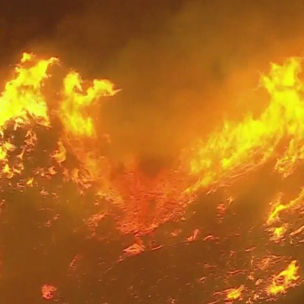 The Apple Fire burns in the Cherry Valley area on July 31, 2020. (KTLA)