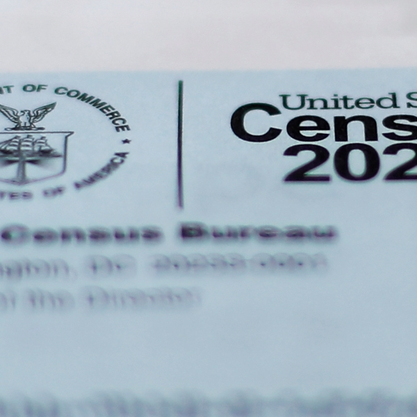 This April 5, 2020, photo shows a 2020 census letter mailed to a U.S. resident in Detroit. The U.S. Census Bureau needs more time to wrap up the once-a-decade count because of the coronavirus, opening the possibility of delays in drawing new legislative districts that could help determine what political party is in power, what laws pass or fail and whether communities of color get a voice in their states. (AP Photo/Paul Sancya)