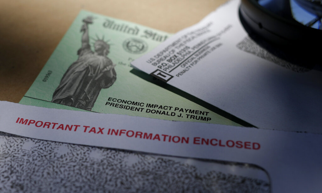President Donald Trump's name is seen on a stimulus check issued by the IRS to help combat the adverse economic effects of the COVID-19 outbreak, in San Antonio, Thursday, April 23, 2020. (AP Photo/Eric Gay)