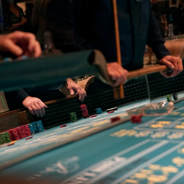 People play craps after the reopening of the Bellagio hotel and casino in Las Vegas on June 4, 2020. (John Locher / Associated Press)