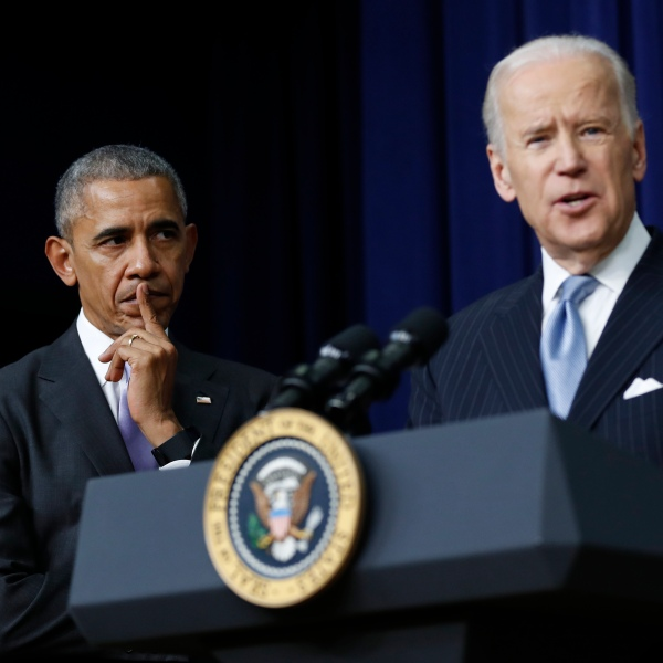 In this Dec. 13, 2016, file photo, President Barack Obama listens as Vice President Joe Biden speaks in the South Court Auditorium in the Eisenhower Executive Office Building on the White House complex in Washington. (AP Photo/Carolyn Kaster, File)