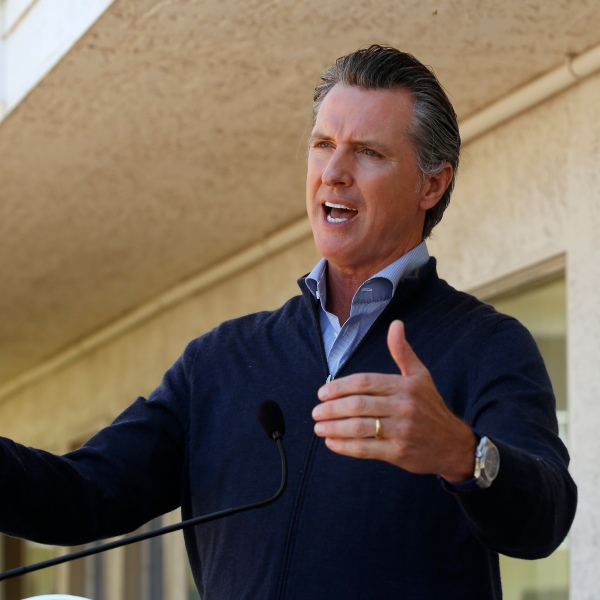 Gov. Gavin Newsom gives an update on the state's initiative to provide housing for homeless Californians to help stem the coronavirus, during a visit to a Motel 6 participating in the program in Pittsburg, Calif., Tuesday, June 30, 2020. (AP Photo/Rich Pedroncelli, Pool)