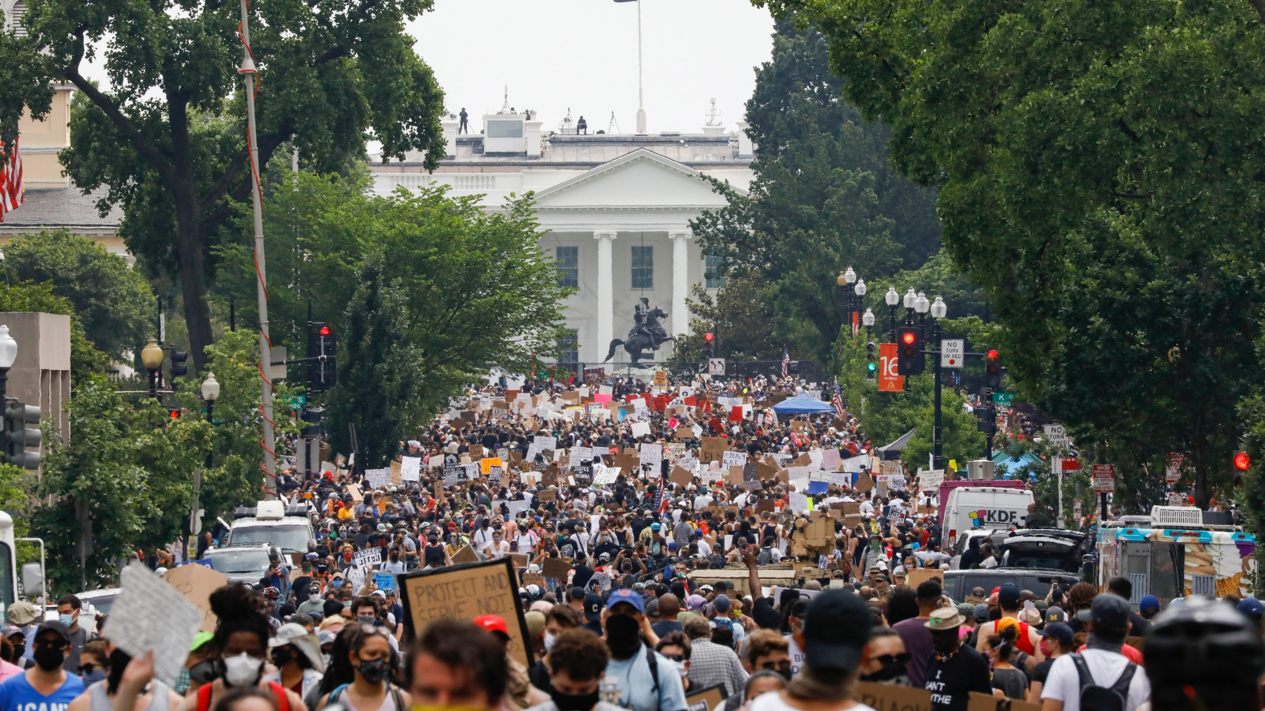 In this Saturday, June 6, 2020 file photo, demonstrators gather near the White House in Washington, to protest the death of George Floyd, a black man who was in police custody in Minneapolis. Public health experts say there is little evidence that the protests that erupted after Floyd's death caused a significant increase in coronavirus infections. If the protests had driven an explosion in cases, experts say, the jumps would have started to become apparent within two weeks — and perhaps as early as five days. (AP Photo/Jacquelyn Martin)
