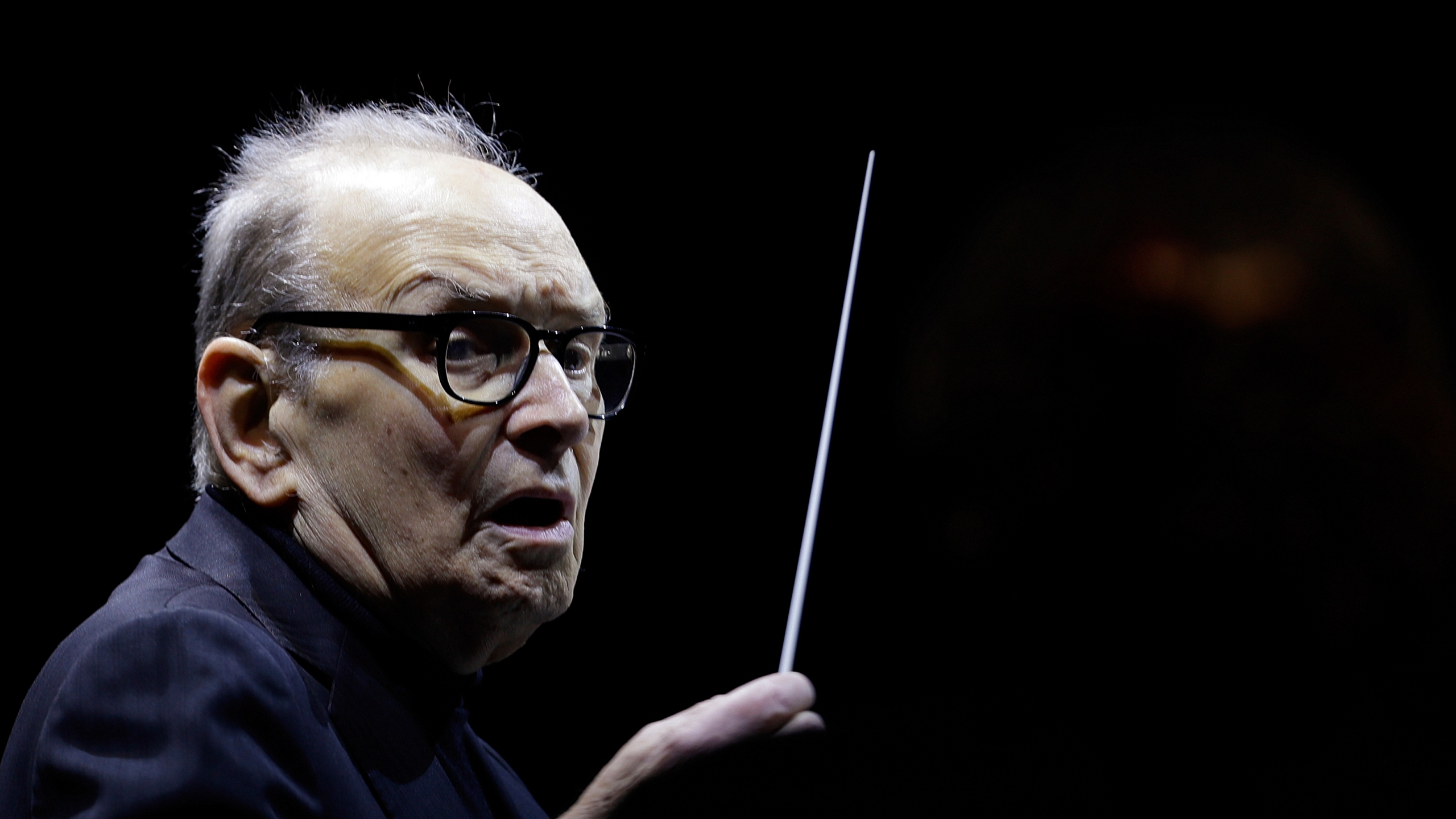 "In this file photo dated Tuesday, March 6, 2018, Italian composer Ennio Morricone directs an ensemble during a concert of his ""60 Years of Music World Tour"", in Milan, Italy."