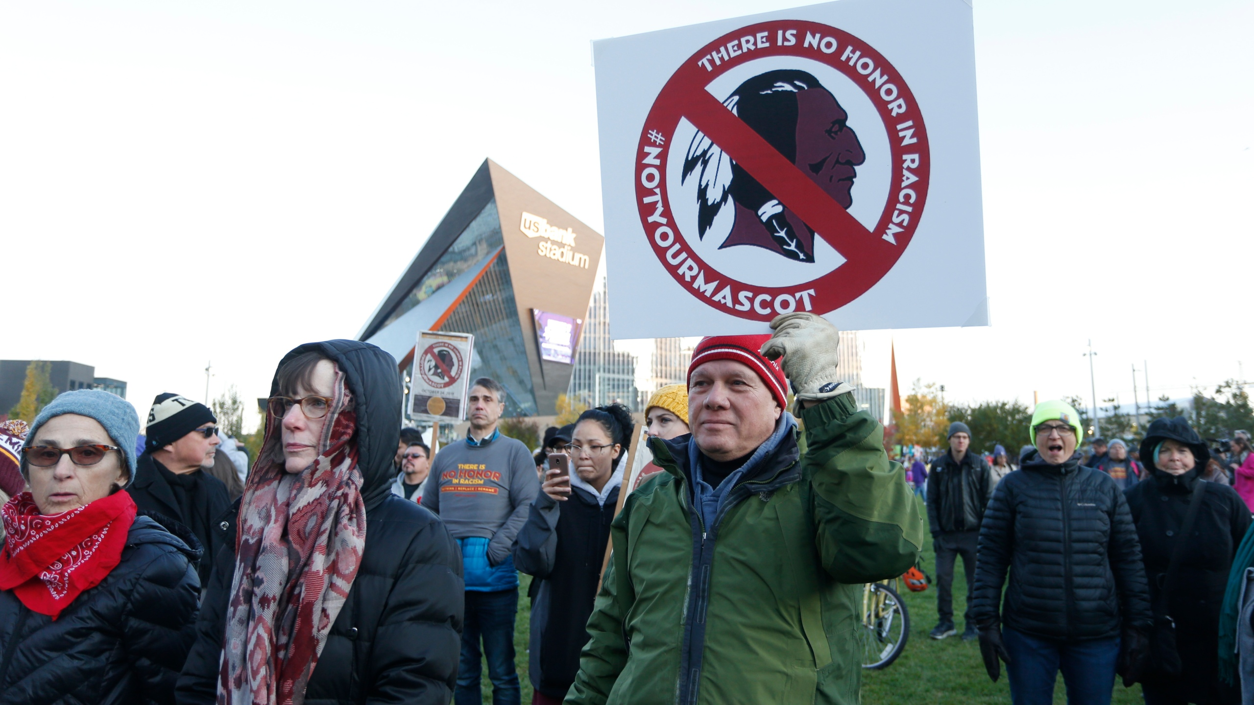 In this Oct. 24, 2019, file photo, Native American leaders protest against the Redskins team name outside U.S. Bank Stadium before an NFL football game between the Minnesota Vikings and the Washington Redskins in Minneapolis. (Bruce Kluckhohn/Associated Press)