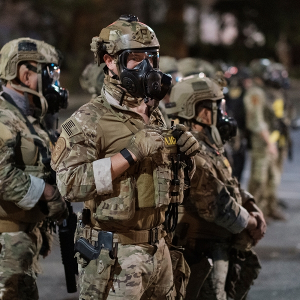 In this photo provided by Doug Brown, agents from different components of the Department of Homeland Security are deployed to protect a federal courthouse in Portland, Oregon, on July 5, 2020. (Doug Brown via Associated Press)