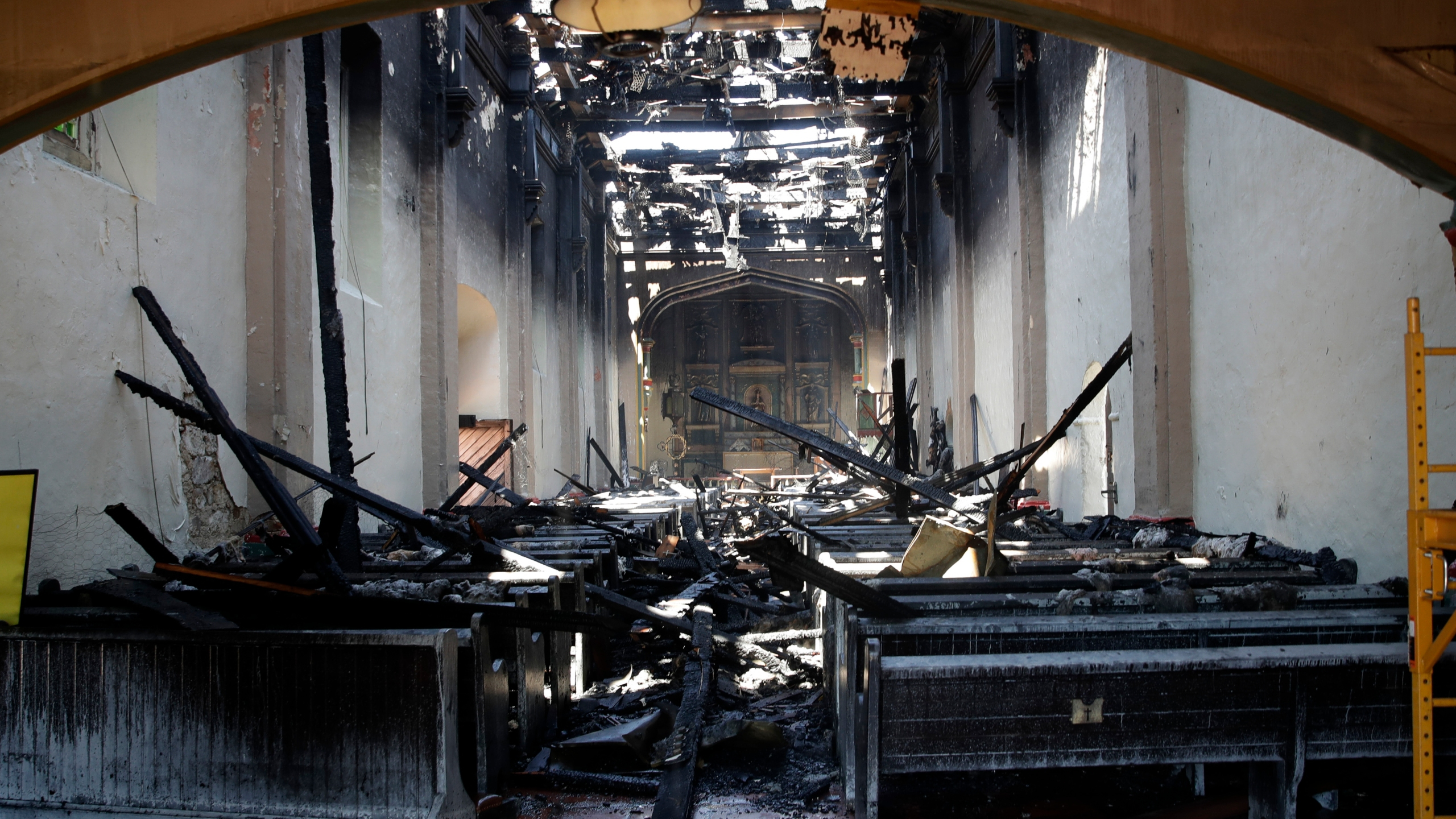 The interior of the San Gabriel Mission is damaged following a morning fire, Saturday, July 11, 2020, in San Gabriel. (AP Photo/Marcio Jose Sanchez)