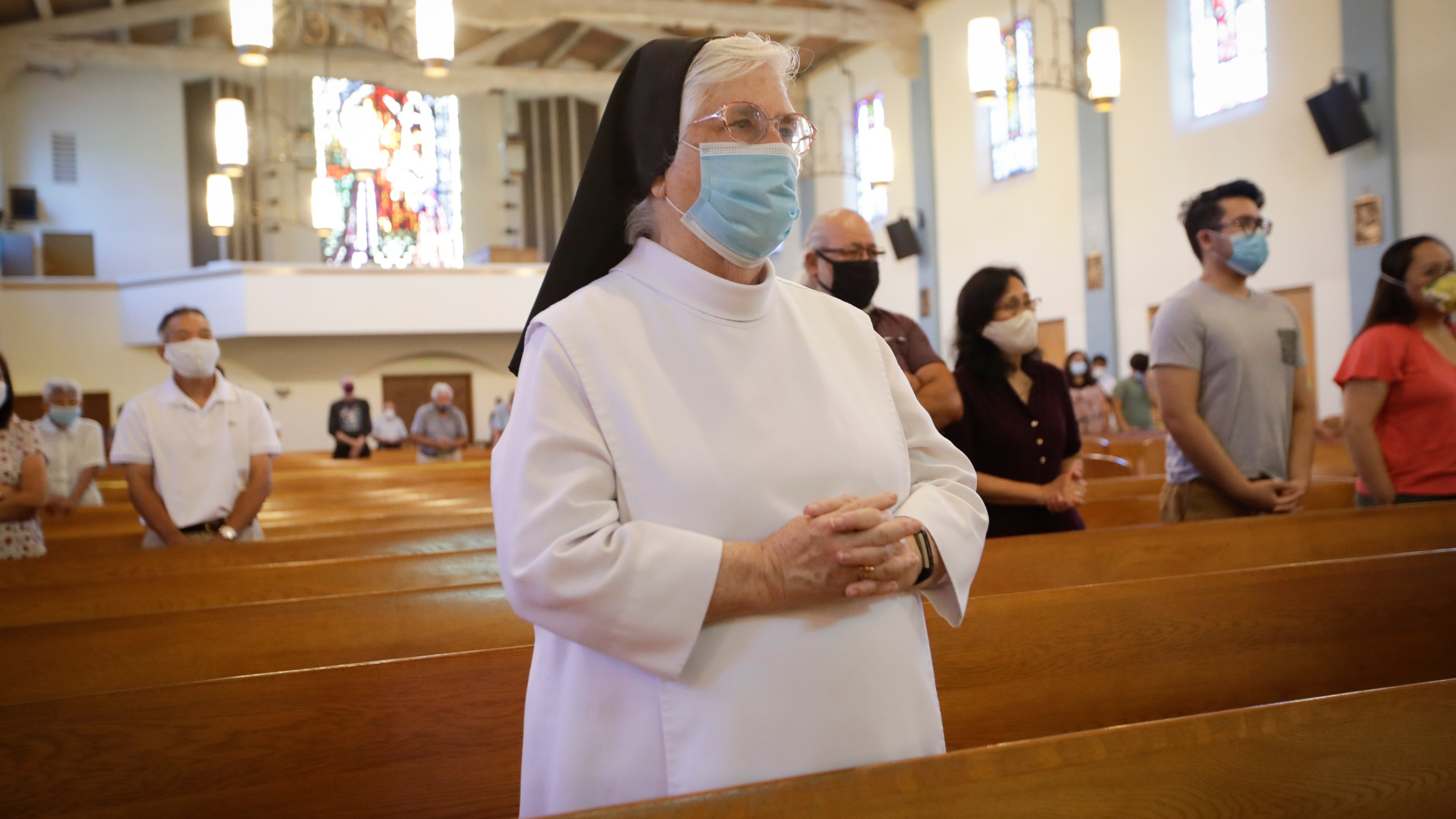 A nun wears a face mask during a service at the San Gabriel Mission, Sunday, July 12, 2020, in San Gabriel amid the coronavirus pandemic. (AP Photo/Marcio Jose Sanchez)
