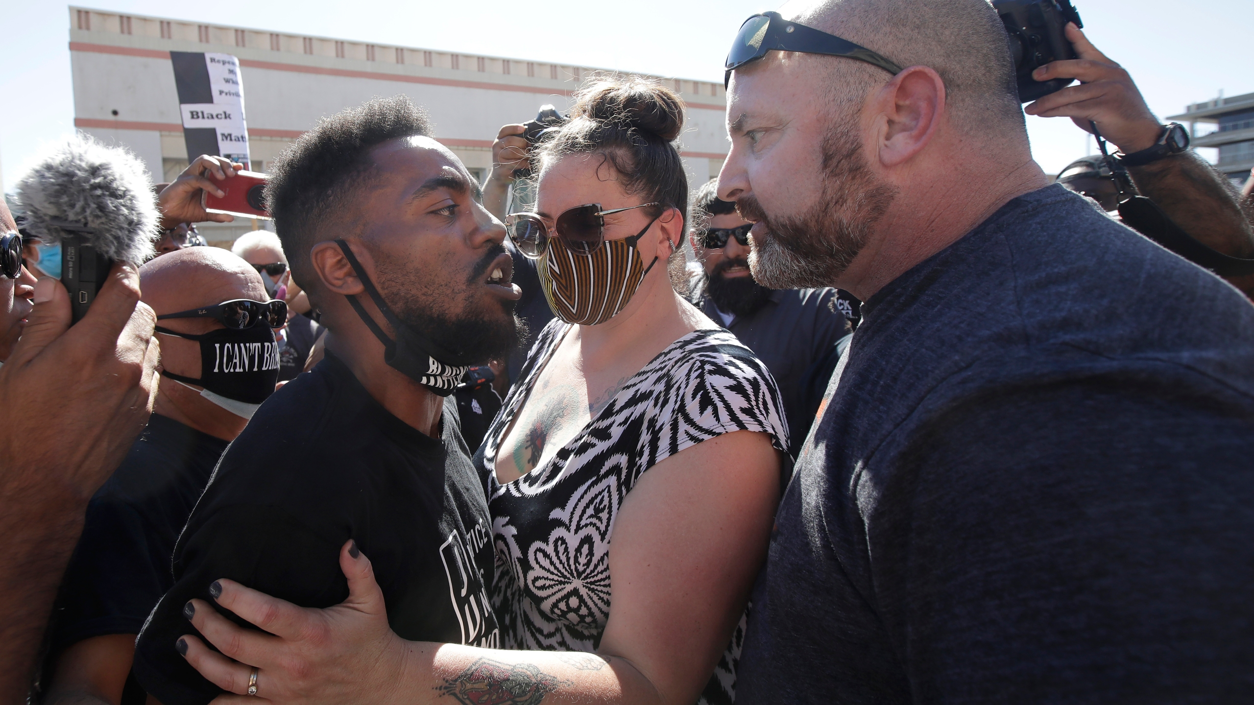 Two people confront each other during a protest calling for an end to racial injustice in Martinez on July 12, 2020. (AP Photo/Jeff Chiu)