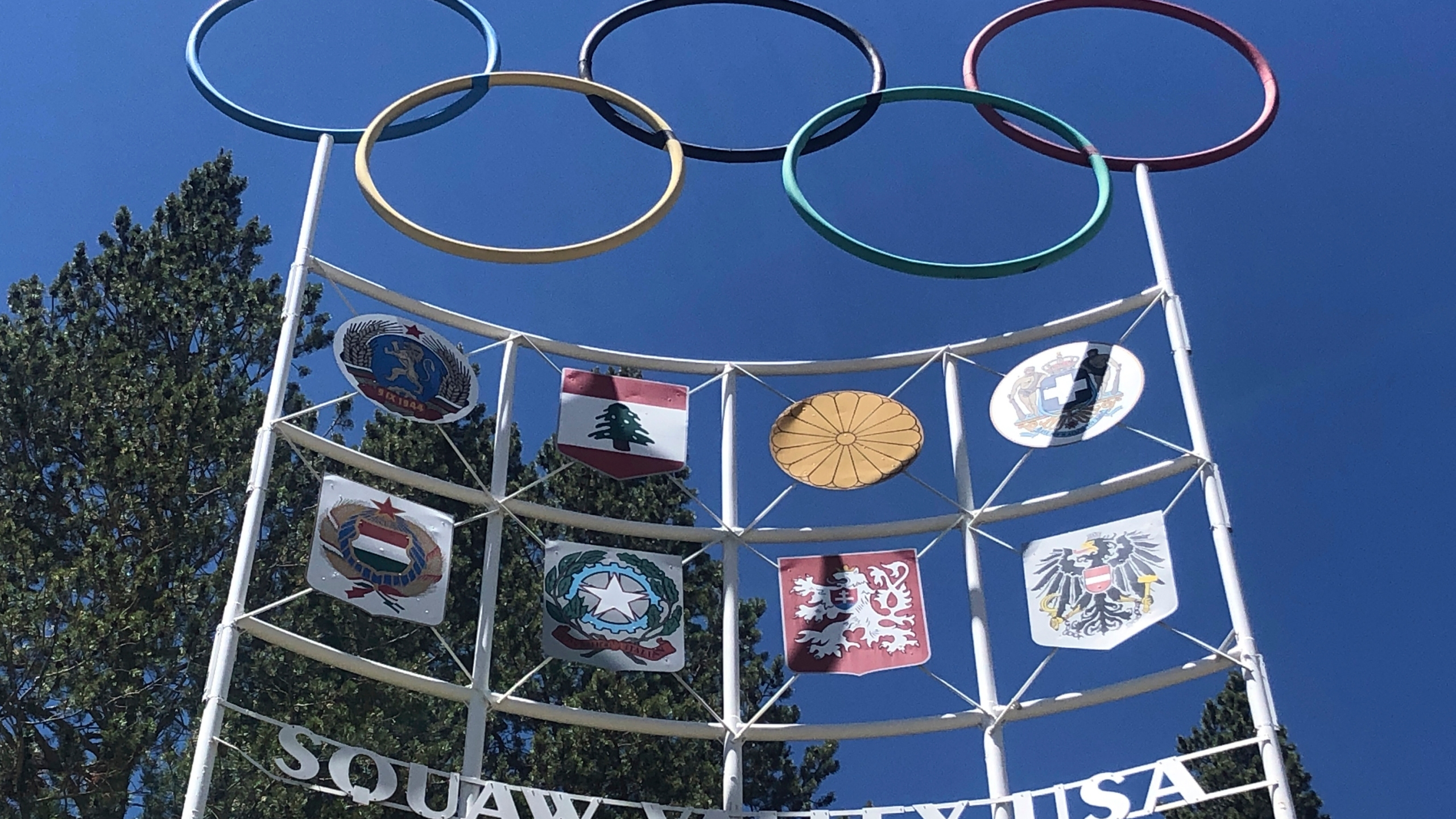 The Olympic rings stand atop a sign at the entrance to the Squaw Valley Ski Resort in Olympic Valley on July 8, 2020. (AP Photo/Haven Daley)