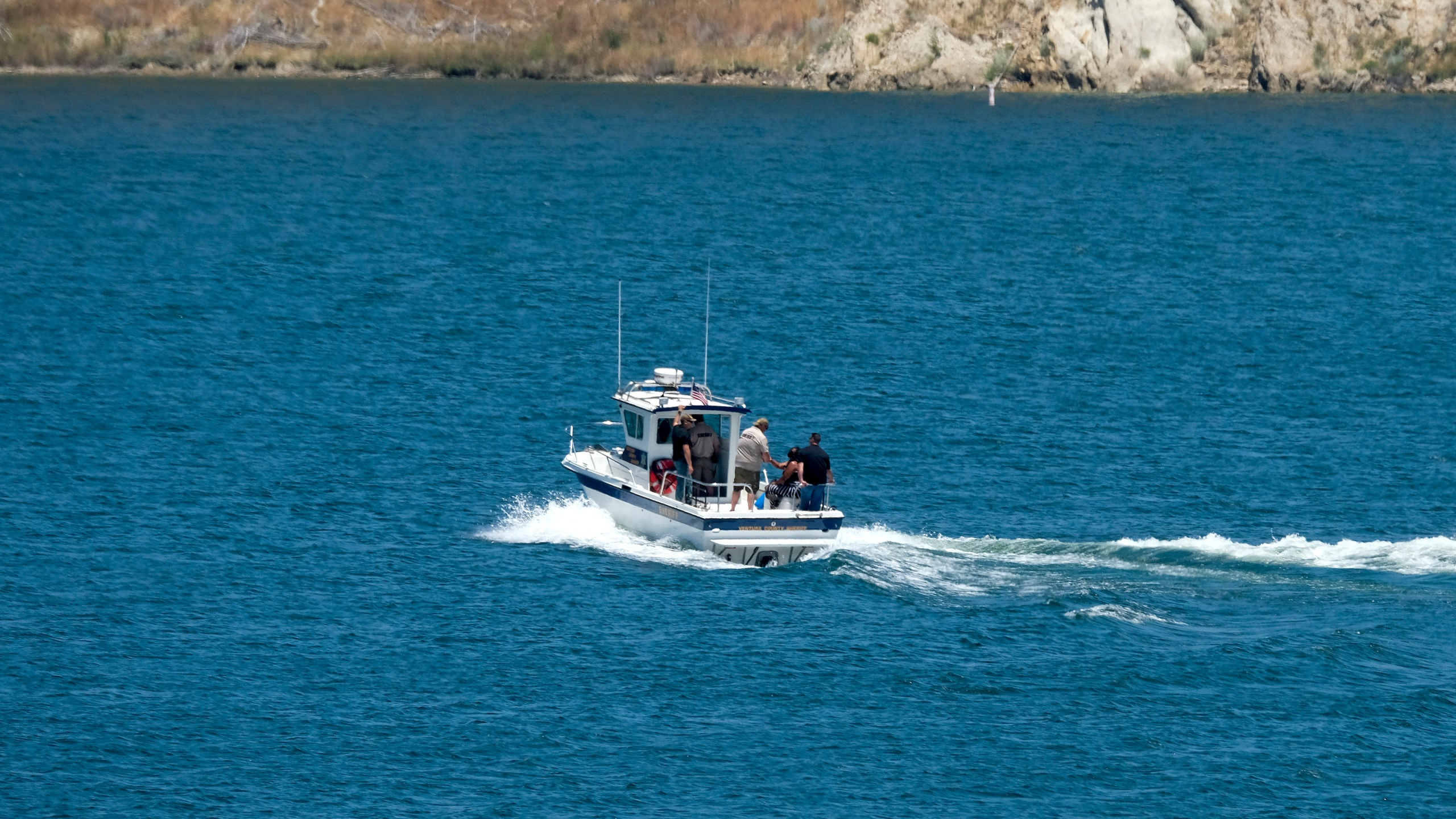 The boat of Ventura County Sheriff's Office with Naya Rivera's father, George Rivera and mother Yolanda onboard is seen after Naya Rivera's body was found in Lake Piru on July 13, 2020. (AP Photo/Ringo H.W. Chiu)
