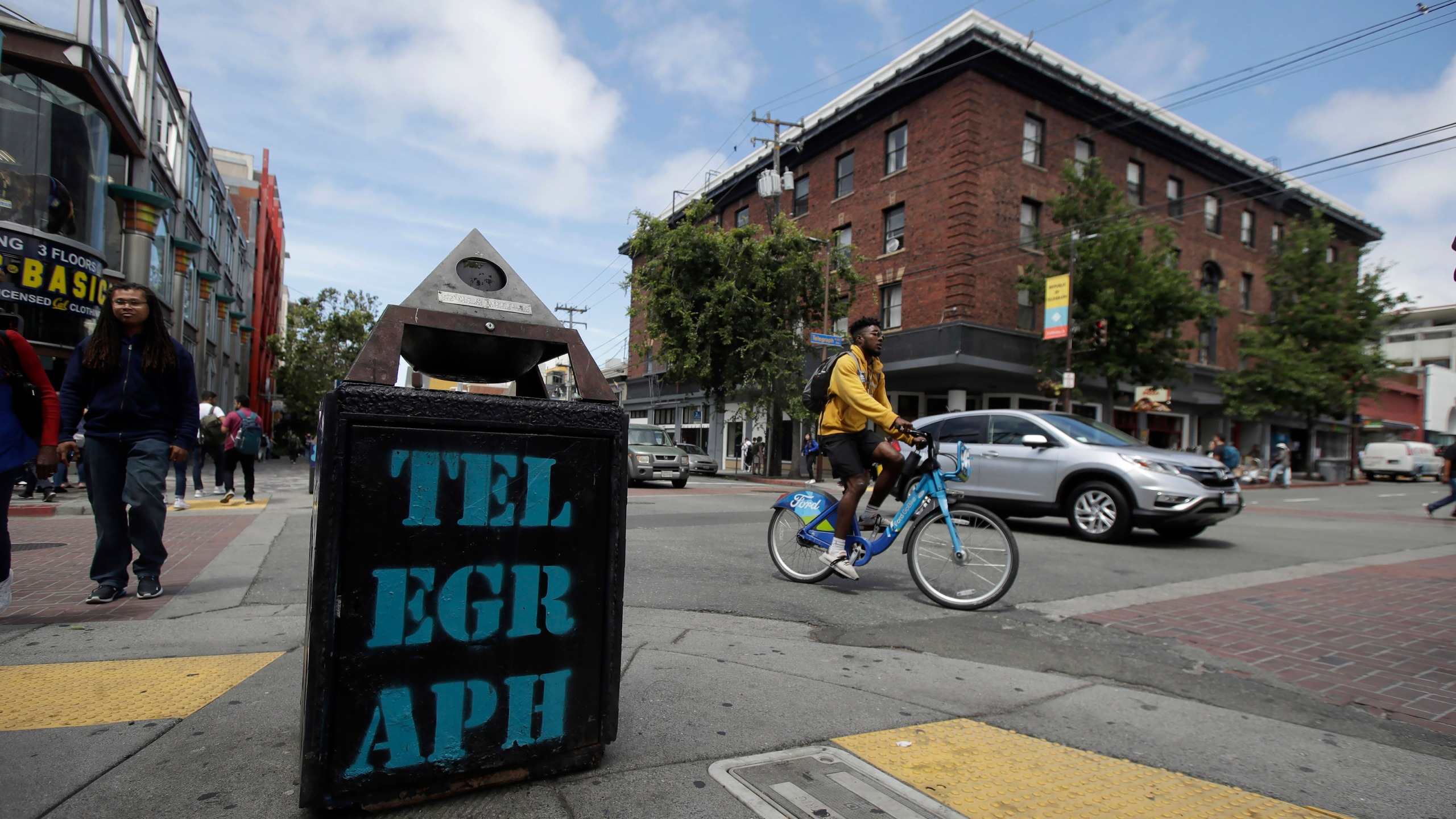 In this file photo from July 18, 2019, traffic and pedestrians cross Telegraph Avenue in Berkeley. (AP Photo/Jeff Chiu, File)