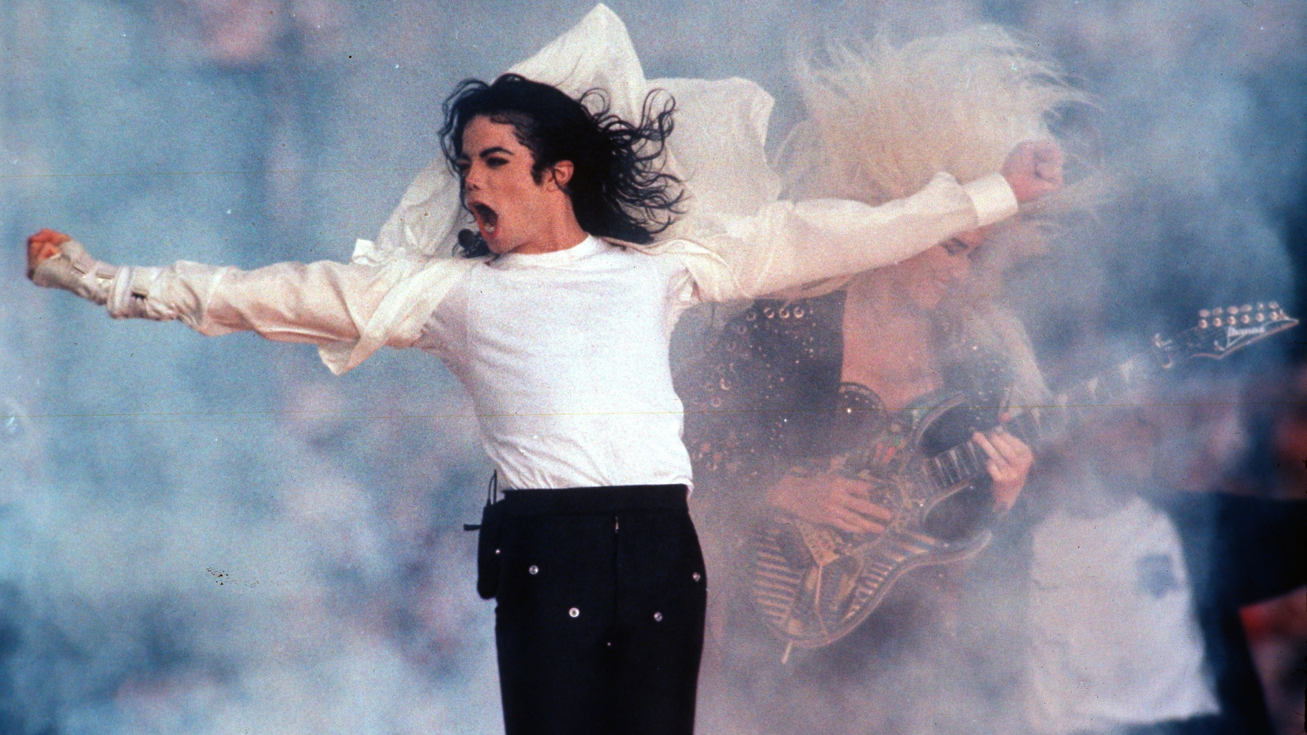 In this Feb. 1, 1993, file photo, Michael Jackson performs during the halftime show at the Super Bowl in Pasadena. (Rusty Kennedy/Associated Press)