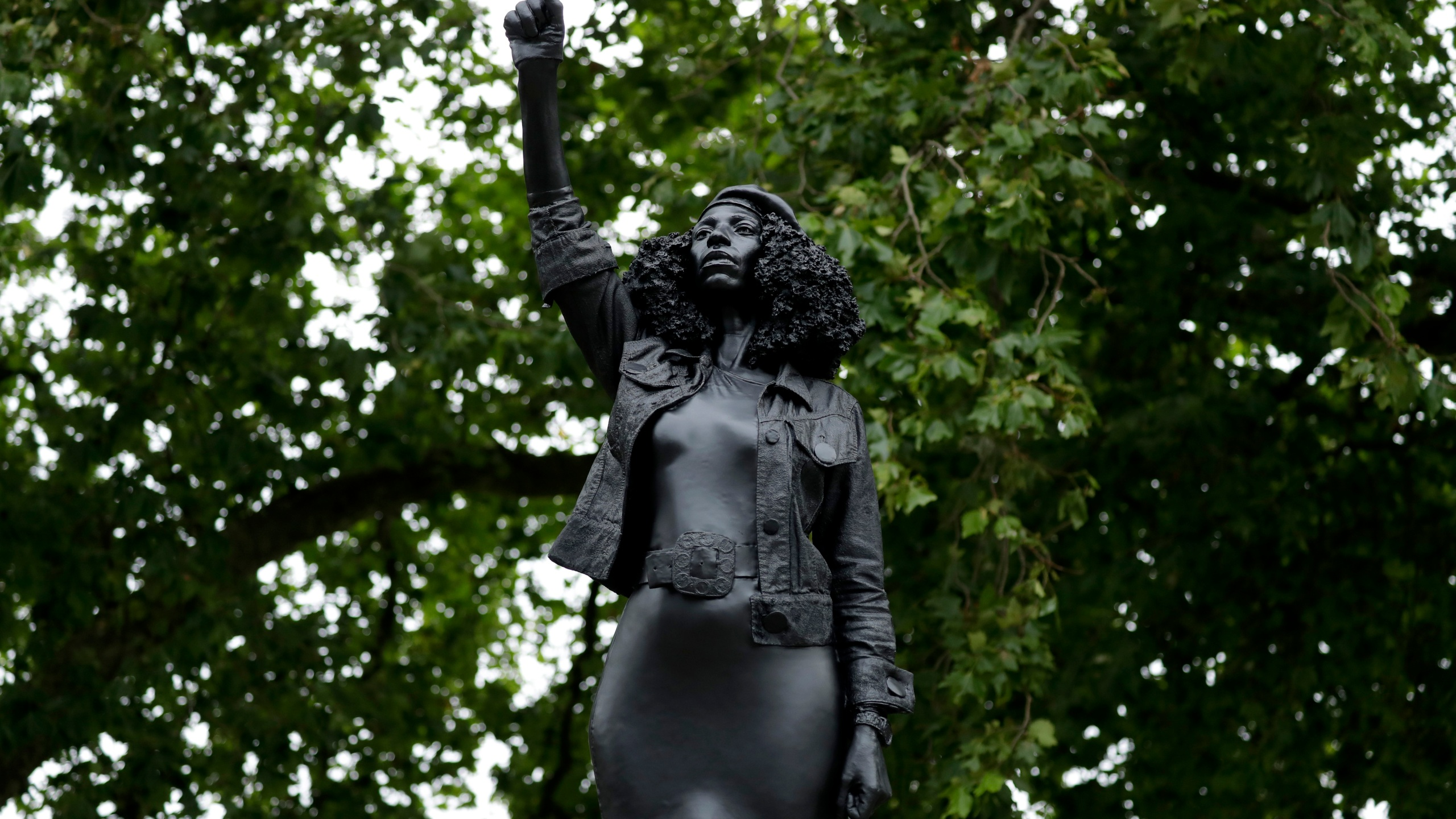 "A statue called ""A Surge of Power (Jen Reid) 2020"" by artist Marc Quinn stands on the empty plinth of the toppled statue of 17th century slave trader Edward Colston, which was pulled down during a Black Lives Matter protest in Bristol, England, on July 15, 2020. (AP Photo/Matt Dunham)"
