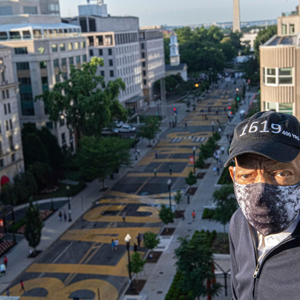 In this June 7, 2020 photo provided by the Executive Office of District of Columbia Mayor Muriel Bowser, John Lewis looks over a section of 16th Street that's been renamed Black Lives Matter Plaza in Washington. (Khalid Naji-Allah/Executive Office of the Mayor via AP)