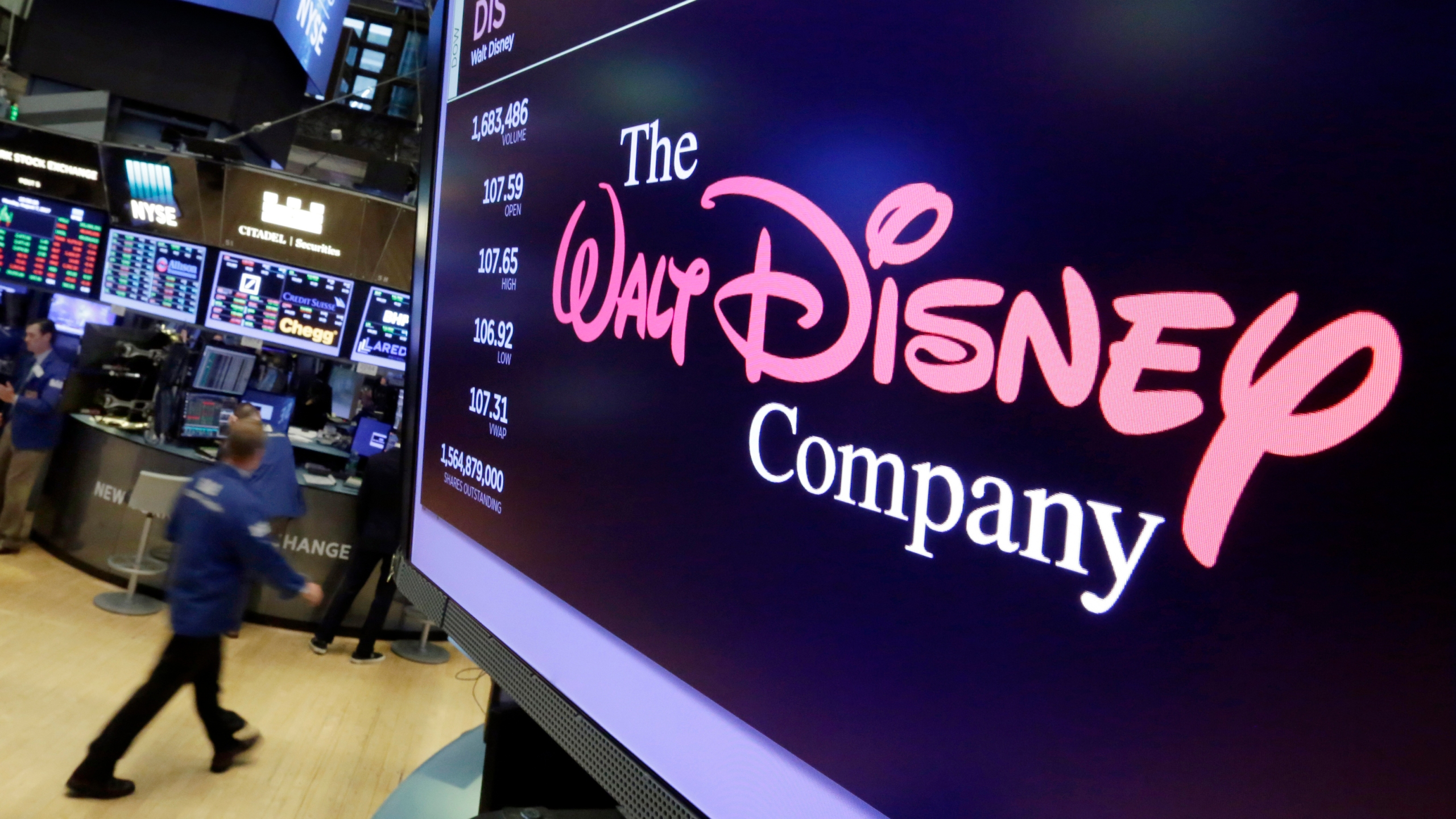 In this Aug. 8, 2017, file photo, The Walt Disney Co. logo appears on a screen above the floor of the New York Stock Exchange. (AP Photo/Richard Drew, File)