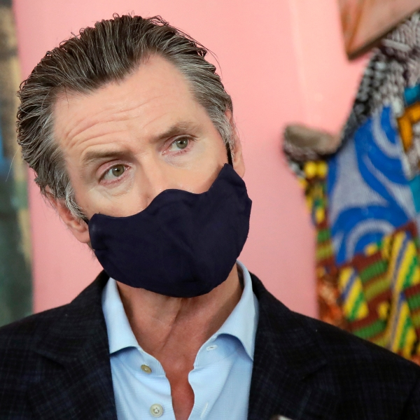 In this June 9, 2020, file photo, California Gov. Gavin Newsom wears a protective mask on his face while speaking to reporters at Miss Ollie's restaurant during the coronavirus outbreak in Oakland, Calif. According to a new poll, Americans overwhelmingly are in favor of requiring people to wear masks around other people outside their homes, reflecting fresh alarm over spiking infection rates. The poll also shows increasing disapproval of the federal government's response to the pandemic. California is among the states seeing the greatest surge in cases now. (AP Photo/Jeff Chiu, Pool, File)