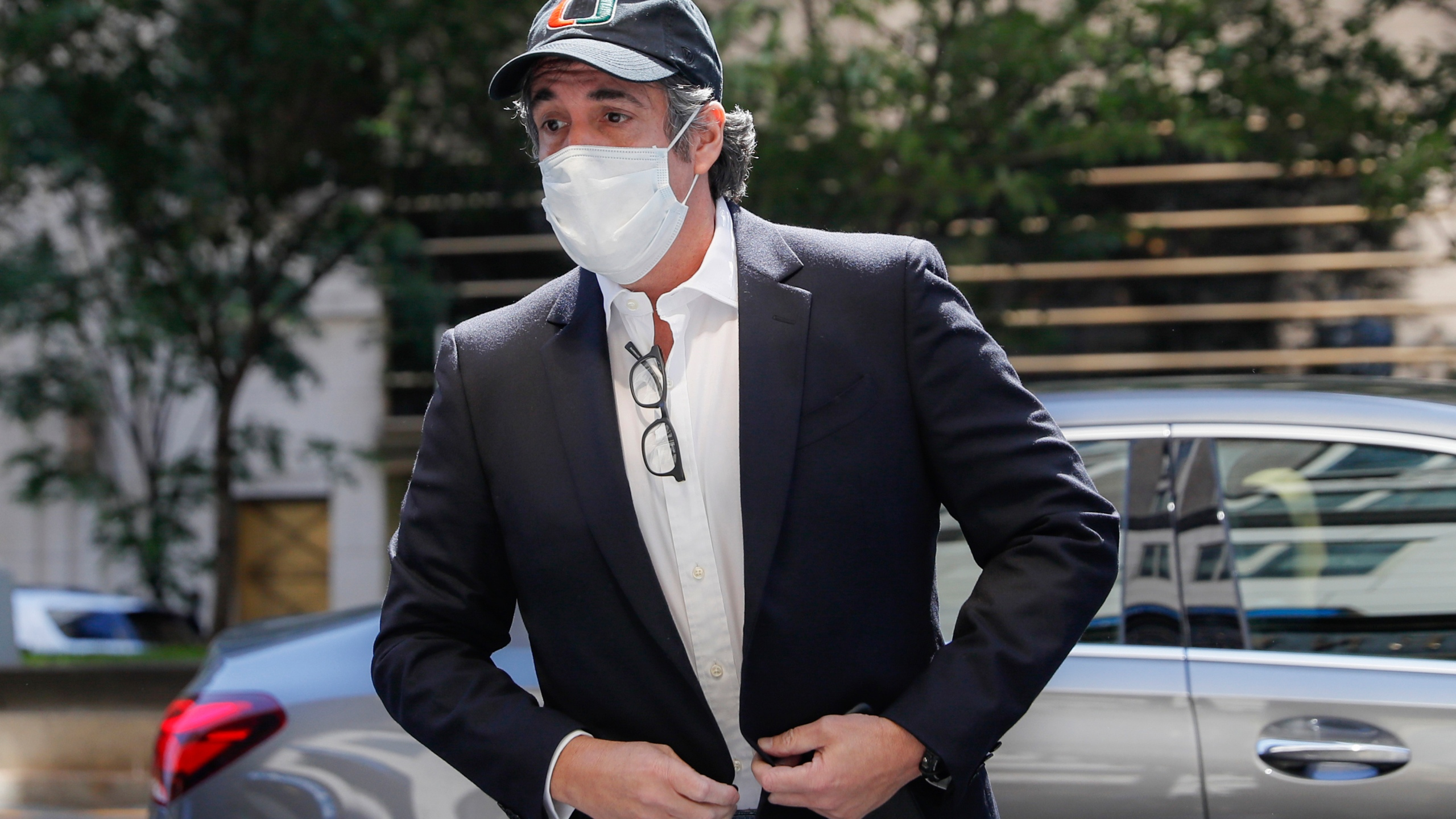 In this May 21, 2020 file photo, Michael Cohen arrives at his Manhattan apartment in New York after being furloughed from prison because of concerns over the coronavirus. (John Minchillo/Associated Press)