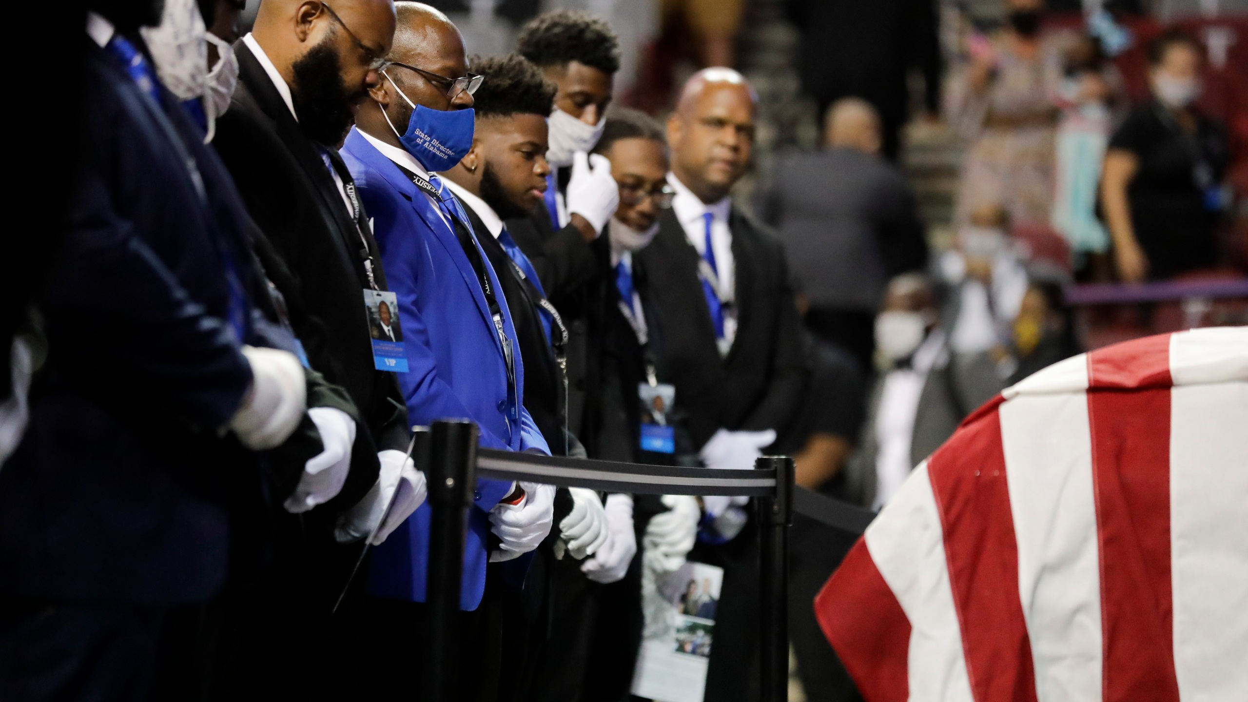 """Fraternity members sing in front of the casket of the late Rep. John Lewis, D-Ga., during a service celebrating """"The Boy from Troy"""" at Troy University on July 25, 2020, in Troy, Ala. (AP Photo/Brynn Anderson)"""