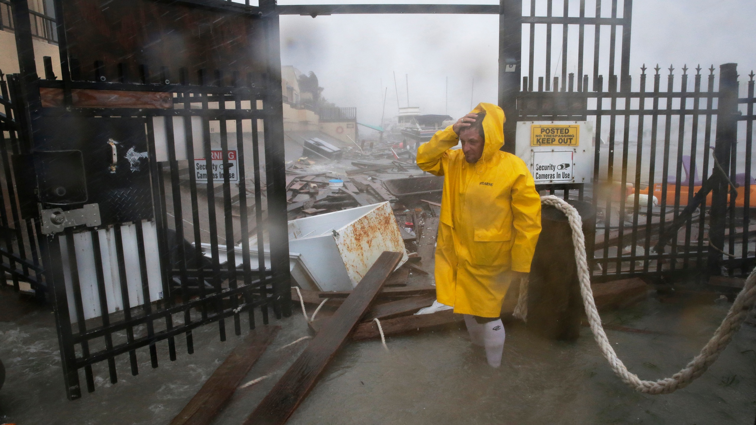 Jame Rowles examines the damage after the docks at the marina where his boat was secured were destroyed as Hurricane Hanna made landfall, July 25, 2020, in Corpus Christi, Texas. (AP Photo/Eric Gay)