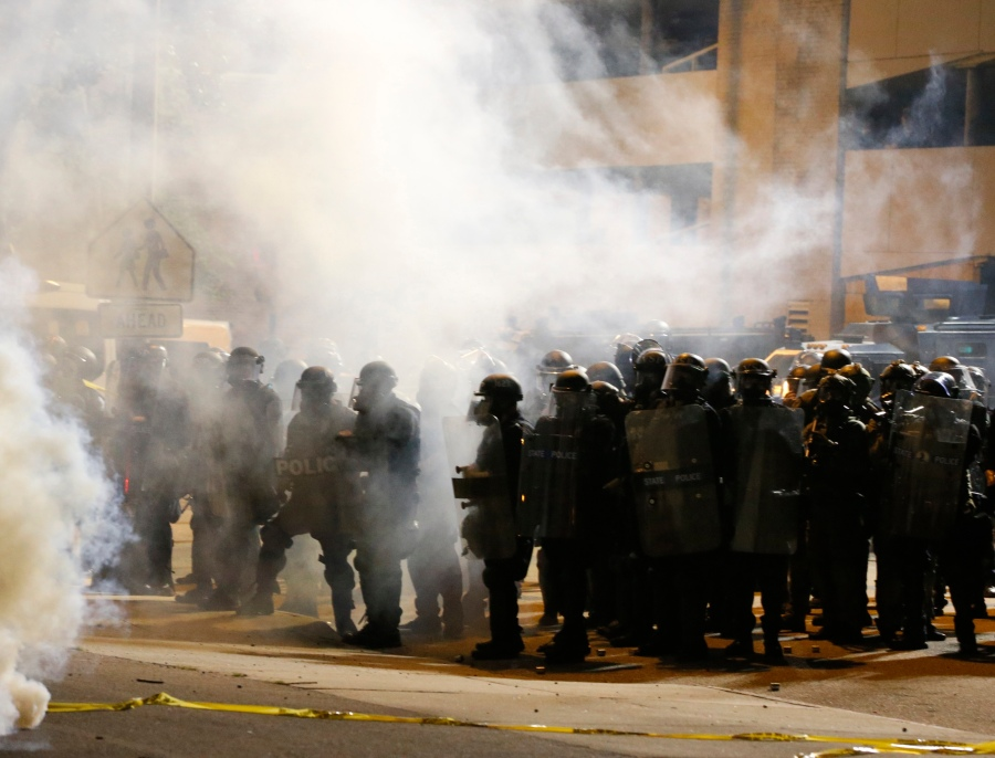 Police and protesters square off outside the Richmond Police Department headquarters on Grace Street in Richmond, Va., Saturday, July 25, 2020. (Joe Mahoney/Richmond Times-Dispatch via AP)