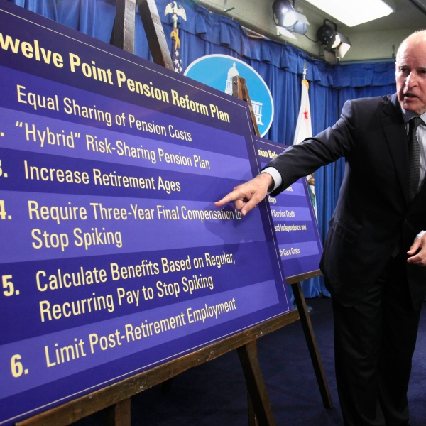 In this Oct. 27, 2011, file photo, Gov. Jerry Brown gestures to a chart showing some of his proposals to rollback public employee pension benefits during a news conference at the Capitol in Sacramento. (AP Photo/Rich Pedroncelli, File)