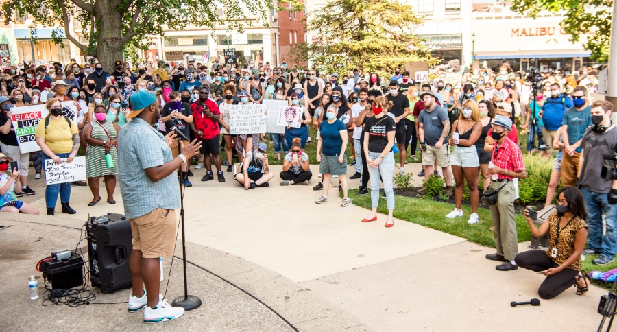 Vauhxx Booker speaks to the hundreds gathered at the Monroe County courthouse on July 6, 2020, in Bloomington, Indiana. (Rich Janzaruk / The Herald-Times via Associated Press)