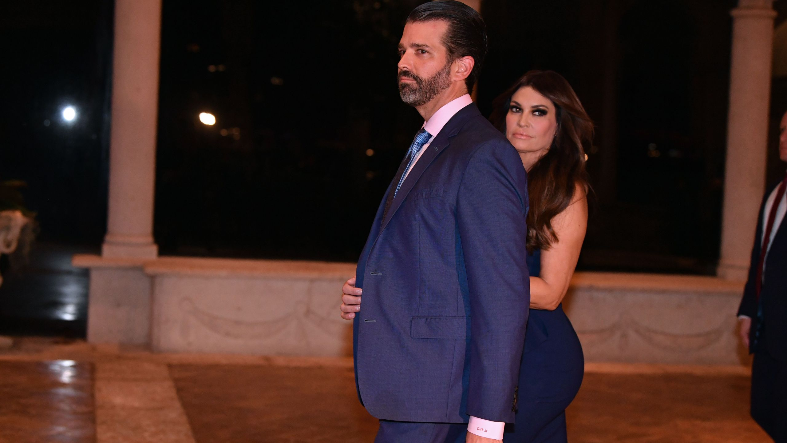 Donald Trump Jr and girlfriend Kimberly Guilfoyle arrive for a Christmas Eve dinner with his family at Mar-A-Lago in Palm Beach, Florida on December 24, 2019. (NICHOLAS KAMM/AFP via Getty Images)