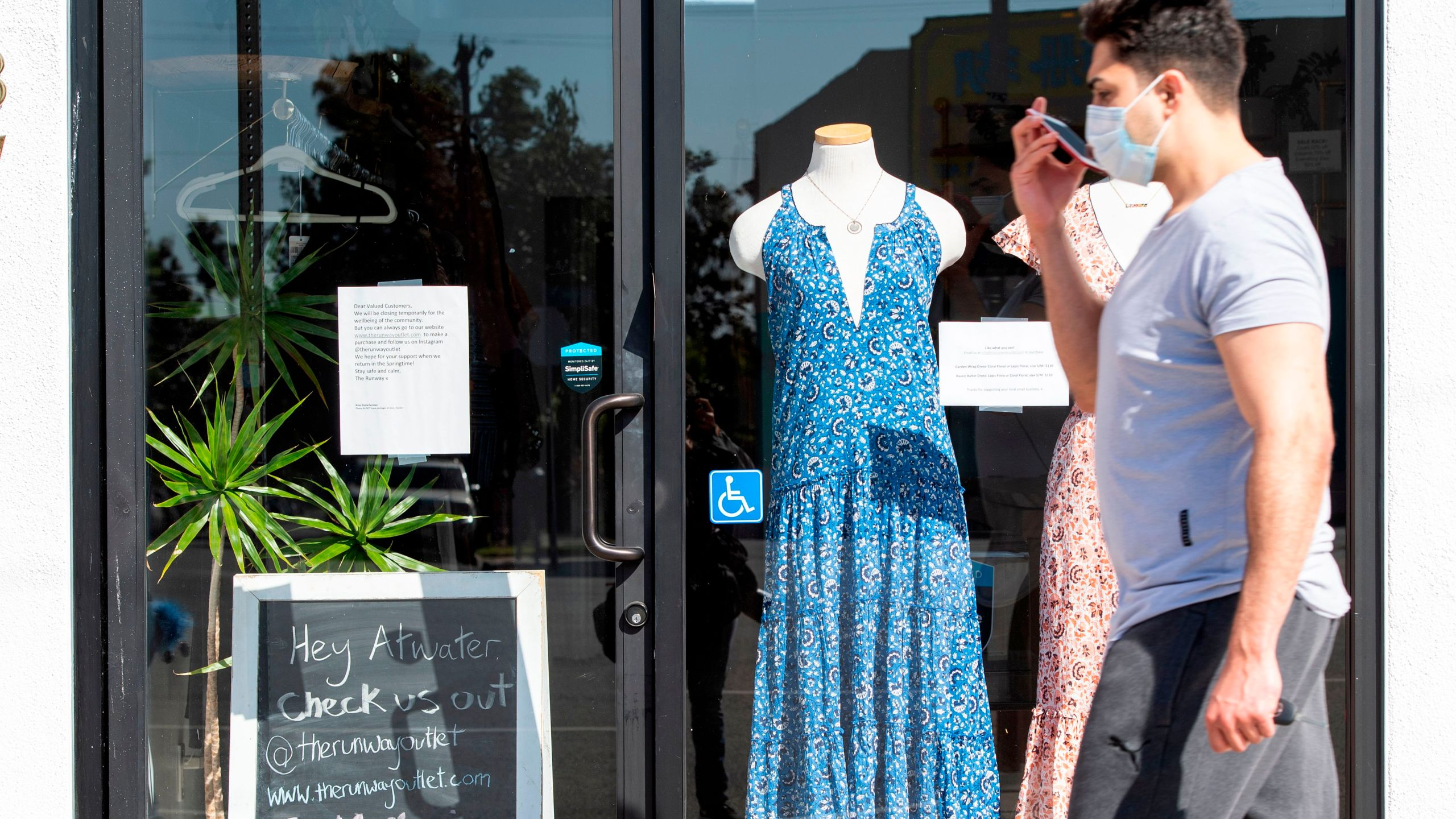 A sign displayed on the door tells the client that the shop is closed due to coronavirus amid the COVID- 19 pandemic, May 4, 2020, in Glendale, California. (VALERIE MACON/AFP via Getty Images)