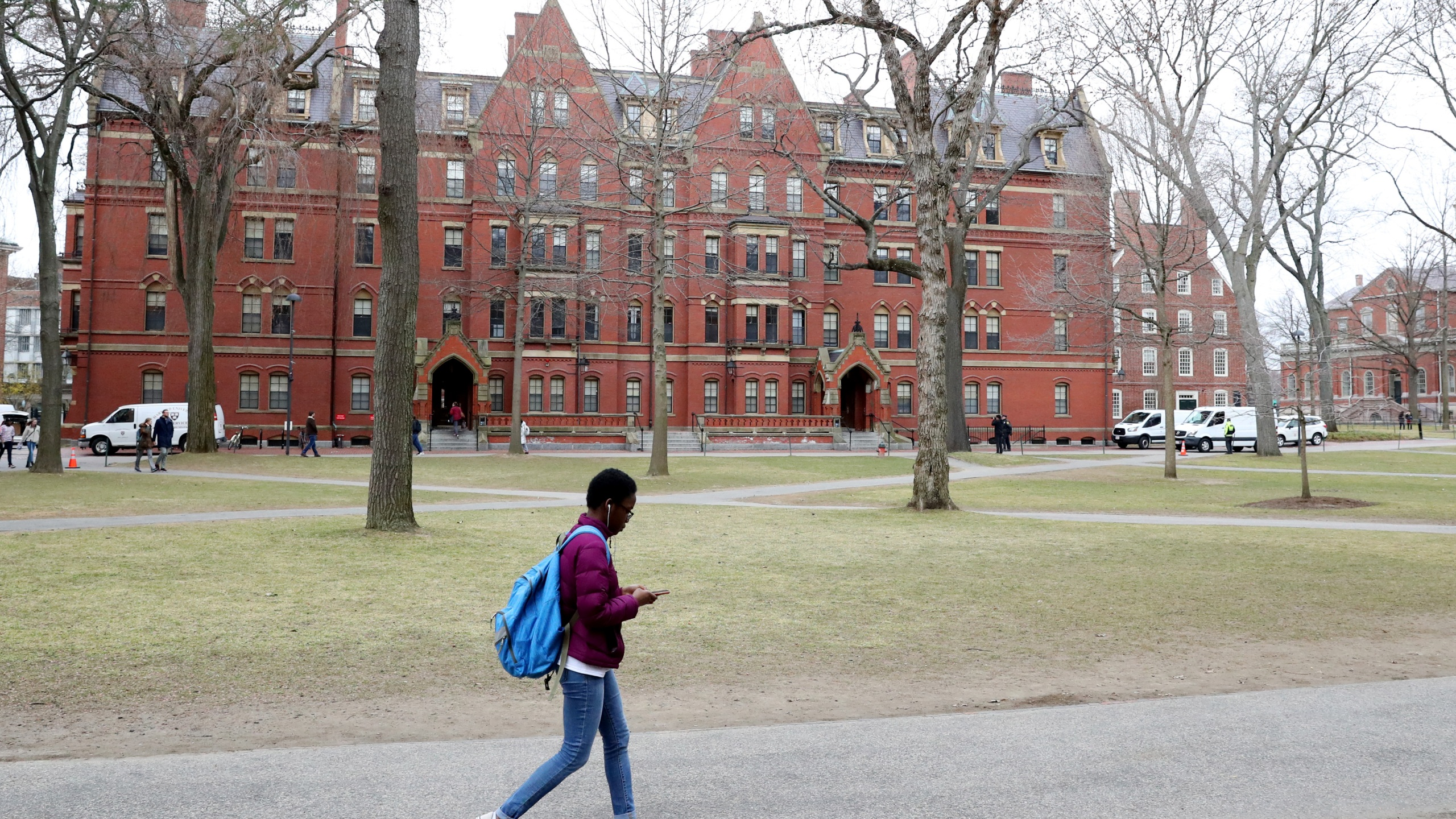 A student walks through Harvard Yard on the campus of Harvard University on March 12, 2020, in Cambridge, Massachusetts. (Maddie Meyer/Getty Images)