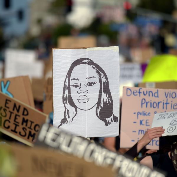 Protesters march holding placards and a portrait of Breonna Taylor during a demonstration against racism and police brutality in Hollywood on June 7, 2020. (Agustin Paullier / AFP / Getty Images)