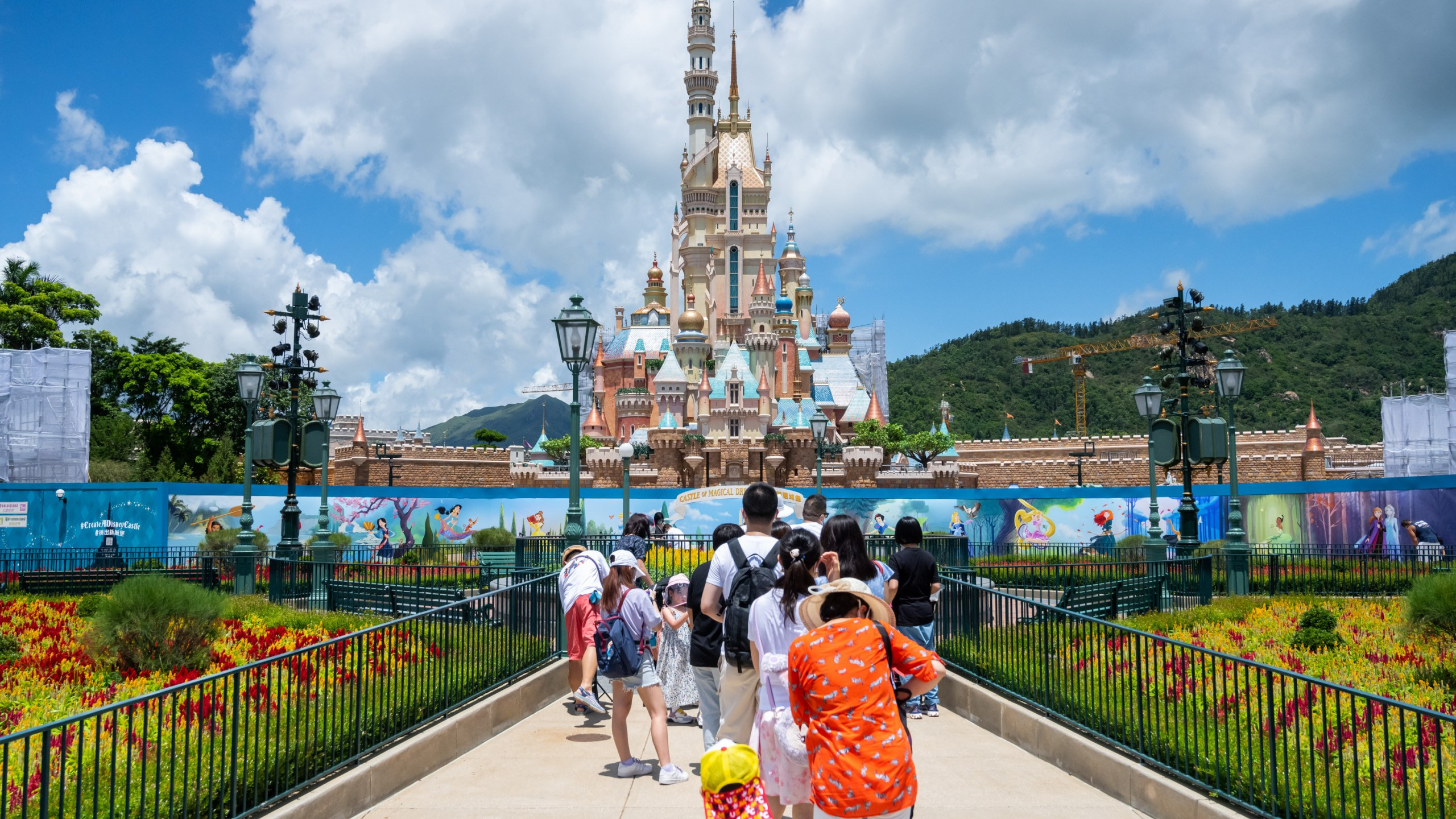 Visitors take photos of the Castle of Magical Dreams at Hong Kong Disneyland on June 18, 2020. (Billy H.C. Kwok/Getty Images)