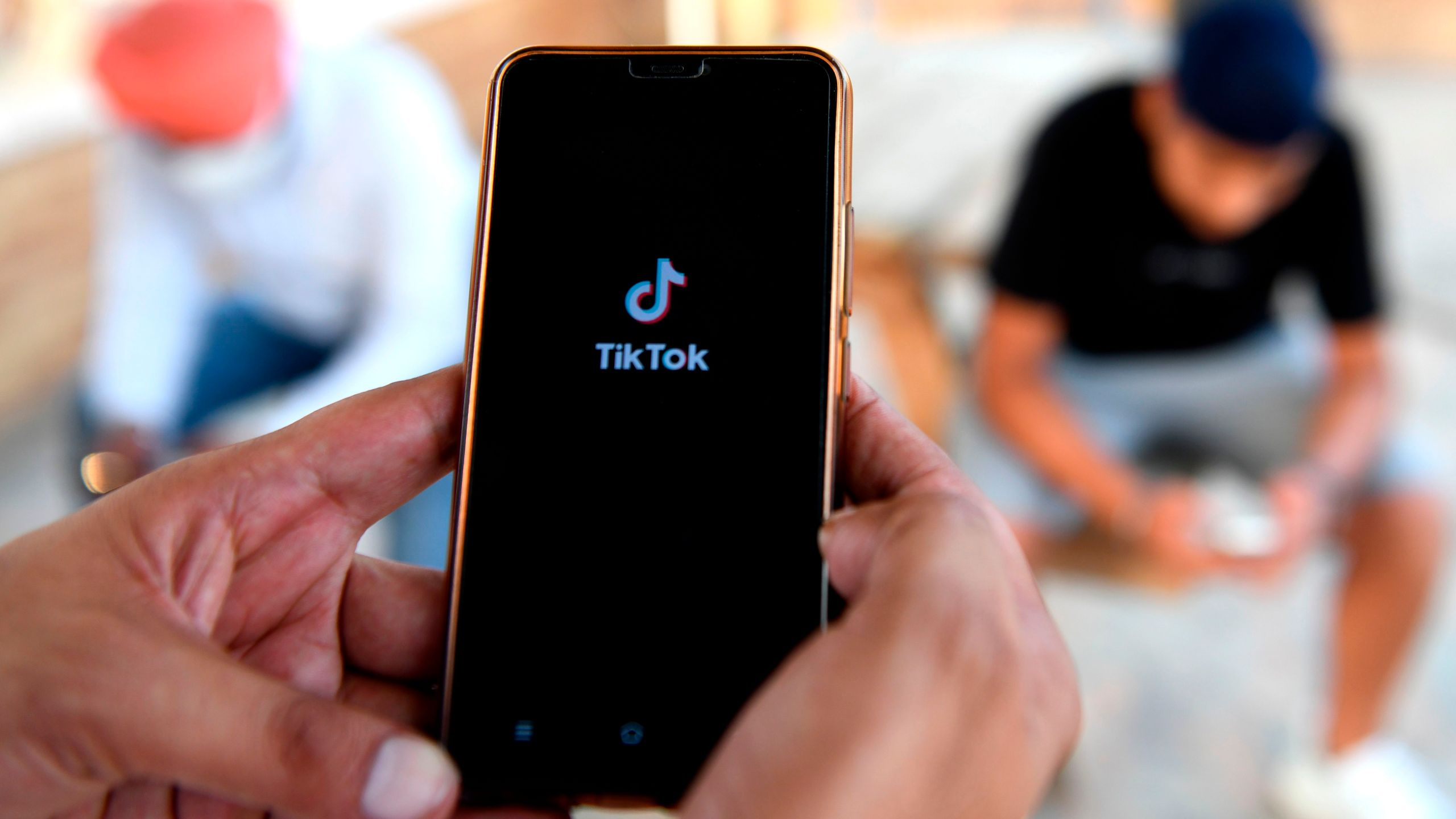 Indian mobile users browse through the Chinese-owned video-sharing 'Tik Tok' app on a smartphones in Amritsar on June 30, 2020. (NARINDER NANU/AFP via Getty Images)