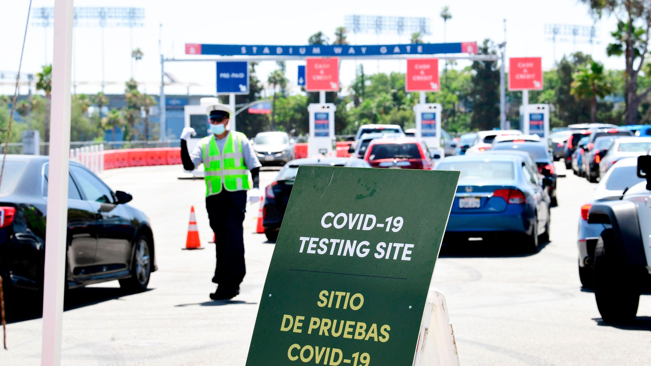 Traffic is directed at Dodger Stadium as people arrive for coronavirus testing on June 30, 2020, in Los Angeles. (FREDERIC J. BROWN/AFP via Getty Images)