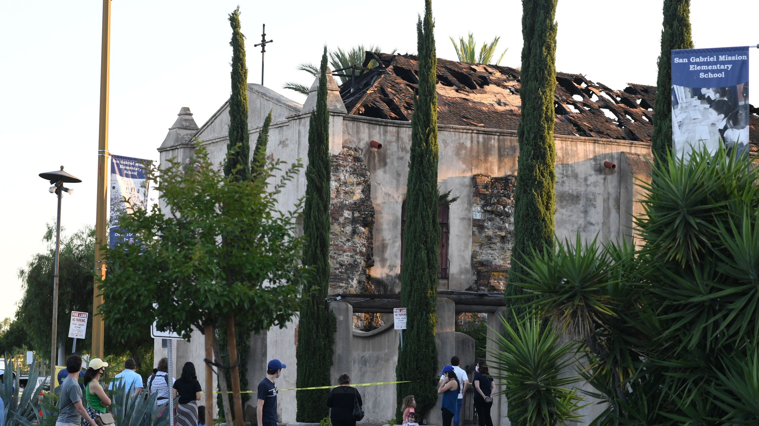 The damaged roof of the San Gabriel Mission is seen after a fire broke out early on July 11, 2020, in San Gabriel. (ROBYN BECK/AFP via Getty Images)