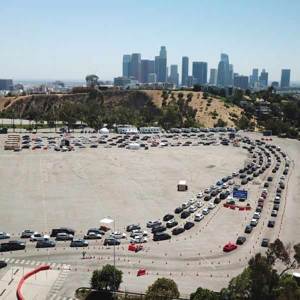 An aerial view shows a long line of cars July 15, 2020, at a COVID-19 testing site at Dodgers Stadium in Los Angeles, California.(ROBYN BECK/AFP via Getty Images)